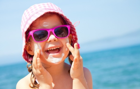 little girl wearing sunglasses on the beach | Williamson Realty