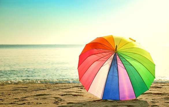 beach umbrella on the beach | Williamson Realty