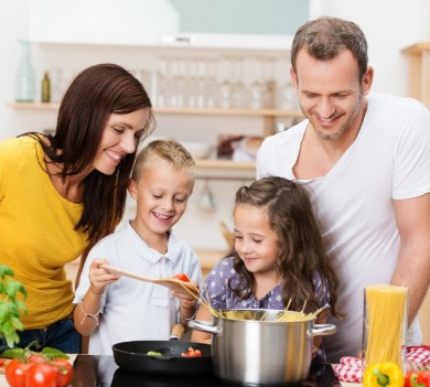 family cooking dinner in their beach vacation rental | Williamson Realty