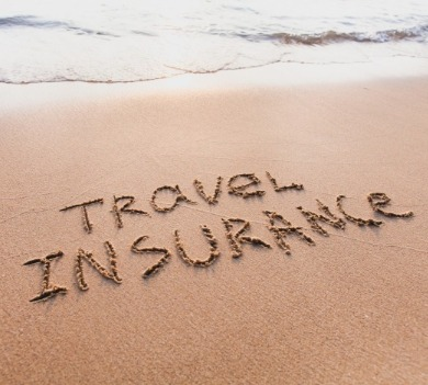 travel insurance written in the sand on the beach | Williamson Realty