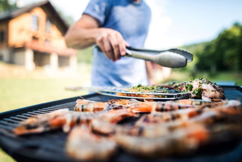 seafood cooking on a grill | Williamson Realty