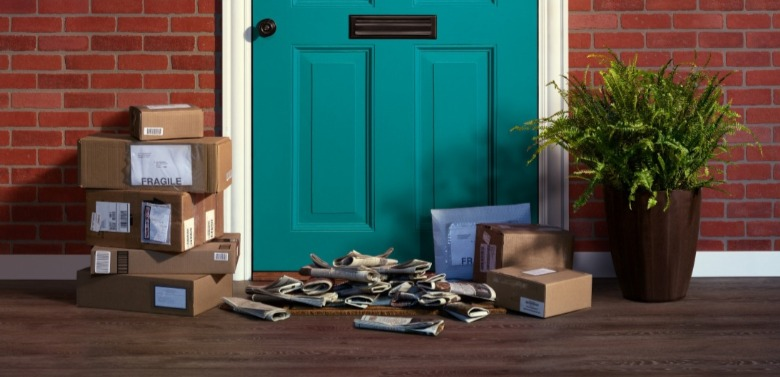packages and newspaper piled up outside door | Williamson Realty