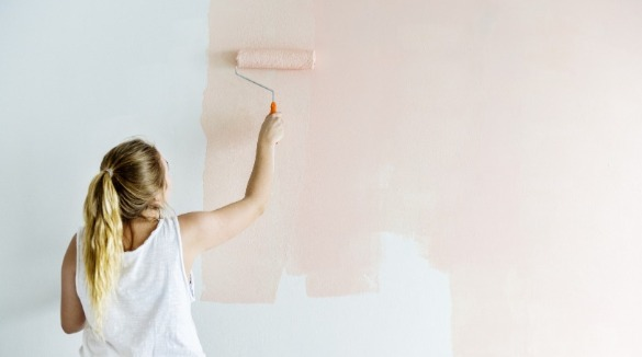 woman painting wall light pink | Williamson Realty