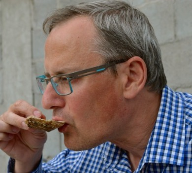 man eating oyster | Williamson Realty