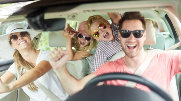 family in car listening to music | Williamson Realty
