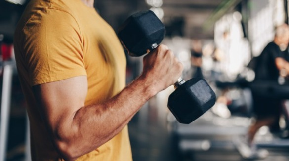 man lifting weights | Williamson Realty