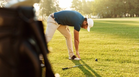 man stretching before playing golf | Williamson Realty