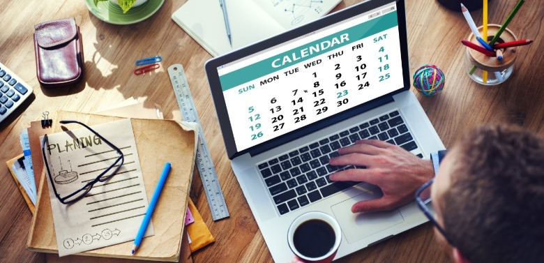 man looking at calendar on computer | Williamson Realty