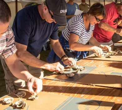 people eating oysters contest | Ocean Isle Beach NC Vacation Rentals | Williamson Realty