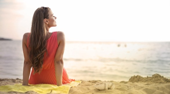 woman relaxing on ocean isle beach | Williamson Realty Vacations