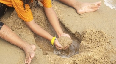 digging holes on ocean isle beach  | WIlliamson Realty Vacations