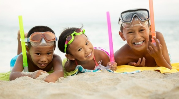 children smiling on ocean isle beach | Williamson Realty Vacations