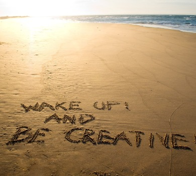 wake up and be creative written in sand on beach | Williamson Realty Vacations