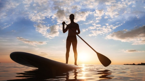 paddleboarding on ocean isle beach | Williamson Realty