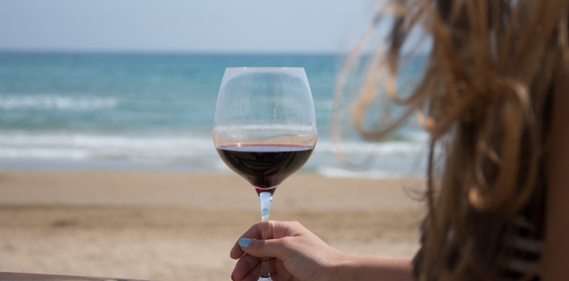 drinking wine on ocean isle beach | Williamson Realty Vacations