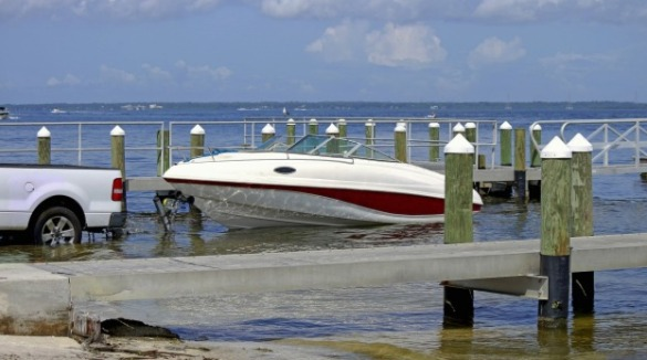 truck unloading boat at boat ramp | Williamson Realty